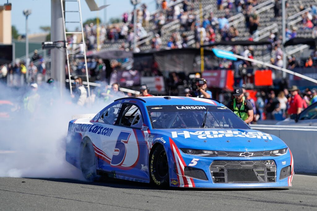 Jun 6, 2021; Sonoma, California, USA;  NASCAR Cup Series driver Kyle Larson (5) does a burnout after winning the Toyota-Save Mart 350 at Sonoma Raceway. Mandatory Credit: Stan Szeto-USA TODAY Sports