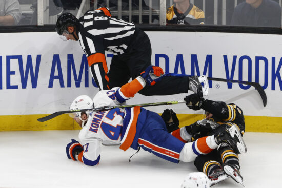 Jun 7, 2021; Boston, Massachusetts, USA; New York Islanders right wing Leo Komarov (47) gets tangled up with Boston Bruins right wing Karson Kuhlman (83) and referee Dave Jackson (8) during the third period of game five of the second round of the 2021 Stanley Cup Playoffs at TD Garden. Mandatory Credit: Winslow Townson-USA TODAY Sports