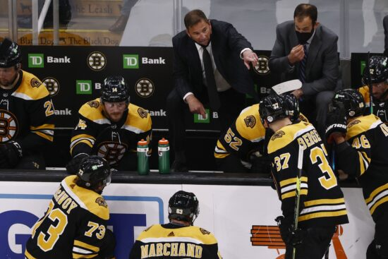 Jun 7, 2021; Boston, Massachusetts, USA; Boston Bruins head coach Bruce Cassidy talks with his players during a timeout in the third period of game five of the second round of the 2021 Stanley Cup Playoffs against the New York Islanders at TD Garden. Mandatory Credit: Winslow Townson-USA TODAY Sports