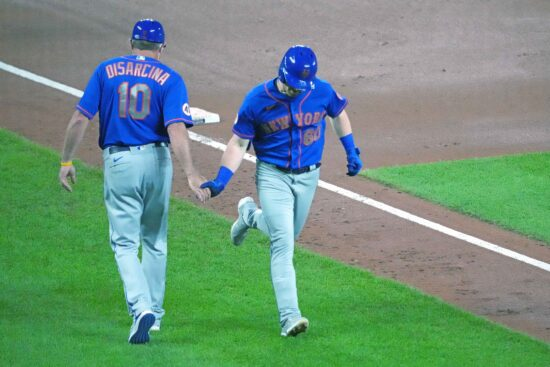 Jun 9, 2021; Baltimore, Maryland, USA; New York Mets outfielder Billy McKinney (60) greeted by coach Gary Disarcina following his solo home run in the fifth inning against the Baltimore Orioles at Oriole Park at Camden Yards. Mandatory Credit: Mitch Stringer-USA TODAY Sports