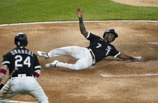 Jun 10, 2021; Chicago, Illinois, USA;  Chicago White Sox shortstop Tim Anderson (7) slides safely to home against the Toronto Blue Jays during the eighth inning at Guaranteed Rate Field. Mandatory Credit: David Banks-USA TODAY Sports