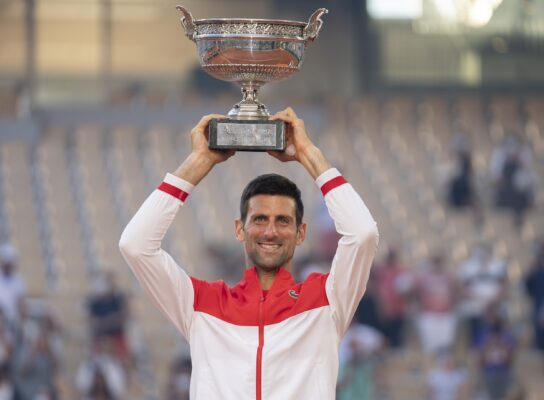 Jun 13, 2021; Paris, France; Novak Djokovic (SRB) poses with the trophy after winning the men's final against Stefanos Tsitsipas (GRE) on day 15 of the French Open at Stade Roland Garros. Mandatory Credit: Susan Mullane-USA TODAY Sports