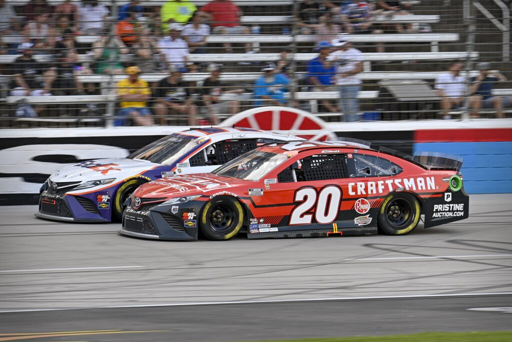Jun 13, 2021; Fort Worth, TX, USA; NASCAR Cup Series driver Denny Hamlin (11) and driver Christopher Bell (20) drives during the NASCAR All-Star Race at Texas Motor Speedway. Mandatory Credit: Jerome Miron-USA TODAY Sports