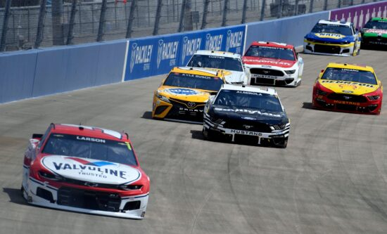 NASCAR Cup Series driver Kyle Larson (5) leads a pack of cars around a turn during the NASCAR Cup Series Ally 400 race at the Nashville Superspeedway in Lebanon, Tenn., Sunday, June 20, 2021.Nascar Cup 006