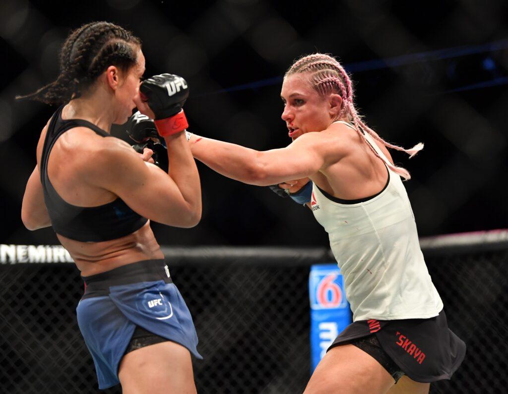 Mar 9, 2019; Wichita, KS, USA;  Yana Kunitskaya (blue gloves) and Marion Reneau (red gloves) during UFC Fight Night at InTrust Arena. Mandatory Credit: Kelly Ross-USA TODAY Sports Images