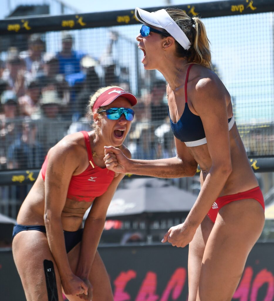 Aug 17, 2019; Manhattan Beach, CA, USA; Alix Klineman (front) and April Ross celebrate after scoring a point in a match with Terese Cannon and Kelly Reeves during the AVP Manhattan Beach Open at Manhattan Beach Pier. Klineman and Ross won the match 2-1 to advance to the semi-finals of the tournament. Mandatory Credit: Robert Hanashiro-USA TODAY Sports