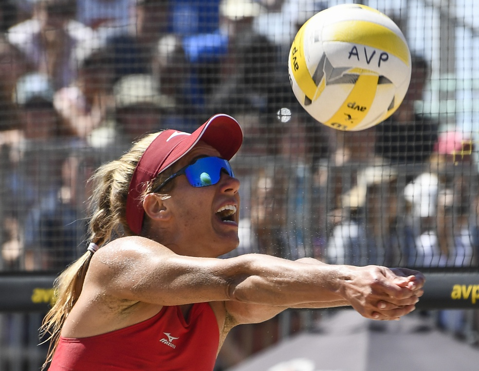Aug 17, 2019; Manhattan Beach, CA, USA; April Ross has the ball reflected in her sunglasses as she returns a shot in a match against Terese Cannon and Kelly Reeves during the AVP Manhattan Beach Open at Manhattan Beach Pier. Ross and Alex Klineman won 2-1 to advance to the semi-finals. Mandatory Credit: Robert Hanashiro-USA TODAY Sports