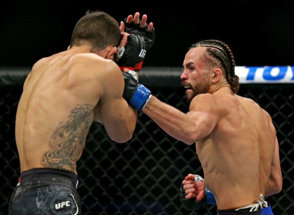 Feb 29, 2020; Norfolk, Virginia, USA; Gabriel Silva (red gloves) fights Kyler Phillips (blue gloves) during UFC Fight Night at Chartway Arena. Mandatory Credit: Peter Casey-USA TODAY Sports