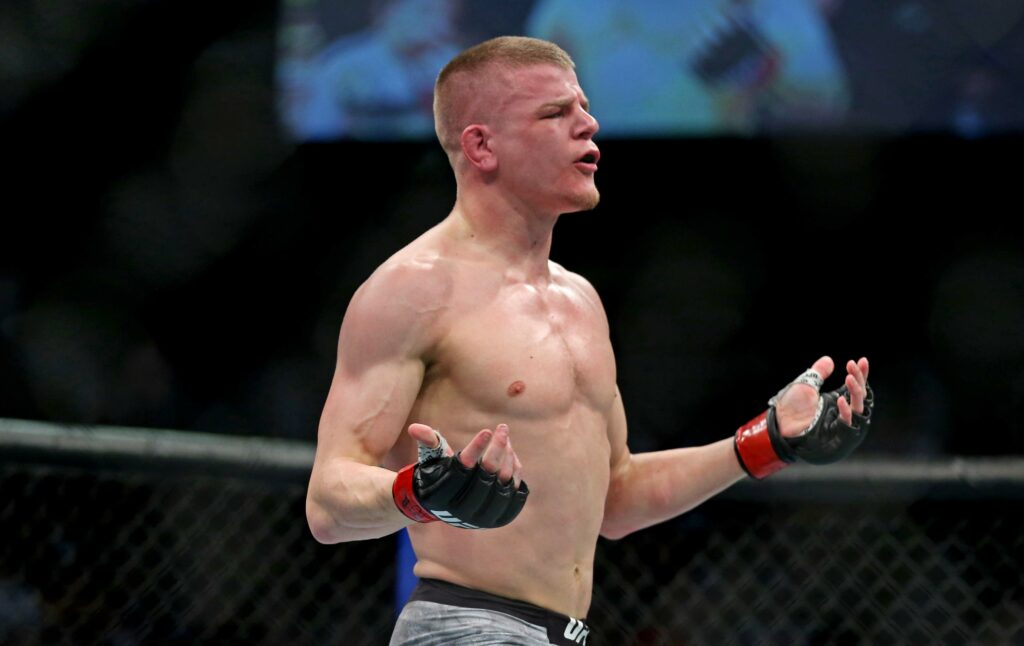 Feb 29, 2020; Norfolk, Virginia, USA; Grant Dawson (red gloves) celebrates beating Darrick Minner (blue gloves) during UFC Fight Night at Chartway Arena. Mandatory Credit: Peter Casey-USA TODAY Sports