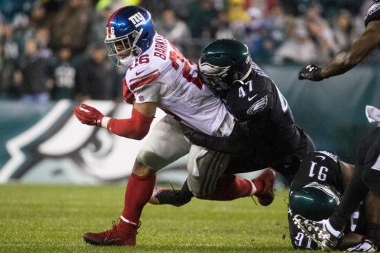 New York's Saquon Barkley (26) is brought down by Philadelphia's Nathan Gerry.Sports Eagles Giants