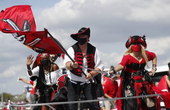 Feb 10, 2021; Tampa Bay, FL, USA; Tampa Bay Buccaneers performers during a boat parade to celebrate victory in Super Bowl LV against the Kansas City Chiefs. Mandatory Credit: Kim Klement-USA TODAY Sports