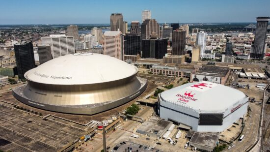 Apr 20, 2021; New Orleans, Louisiana, USA;  Detailed aerial  view of the Smoothie King Center and Mercedes Benz Superdome before the game between the New Orleans Pelicans and the Brooklyn Nets at the Smoothie King Center. Mandatory Credit: Stephen Lew-USA TODAY Sports