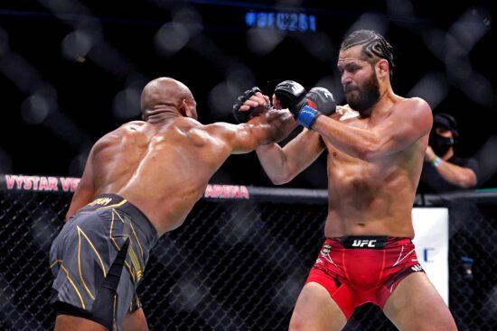 Apr 24, 2021; Jacksonville, Florida, USA; Kamaru Usman (Red Gloves) fights Jorge Masvidal (Blue Gloves) during UFC 261 at VyStar Veterans Memorial Arena. Mandatory Credit: Jasen Vinlove-USA TODAY Sports
