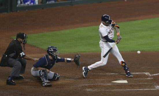 Apr 29, 2021; Houston, Texas, USA; Houston Astros shortstop Carlos Correa (1) hits a double against the Seattle Mariners in the seventh inning at Minute Maid Park. Mandatory Credit: Thomas Shea-USA TODAY Sports