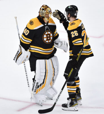 May 29, 2021; Boston, MA, USA; Boston Bruins defenseman Brandon Carlo (25) congratulates goaltender Tuukka Rask (40) after defeating the New York Islanders in game one of the second round of the 2021 Stanley Cup Playoffs at TD Garden. Mandatory Credit: Bob DeChiara-USA TODAY Sports