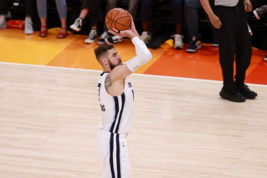 Jun 2, 2021; Salt Lake City, Utah, USA; Memphis Grizzlies center Jonas Valanciunas (17) shoots a three point shot against the Utah Jazz during the second quarter in game five of the first round of the 2021 NBA Playoffs at Vivint Arena. Mandatory Credit: Chris Nicoll-USA TODAY Sports