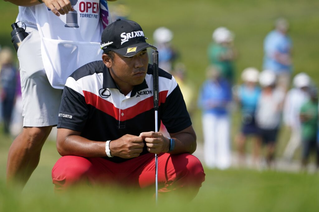 Jun 17, 2021; San Diego, California, USA; Hideki Matsuyama lines up a putt on the fifth green during the first round of the U.S. Open golf tournament at Torrey Pines Golf Course. Mandatory Credit: Michael Madrid-USA TODAY Sports