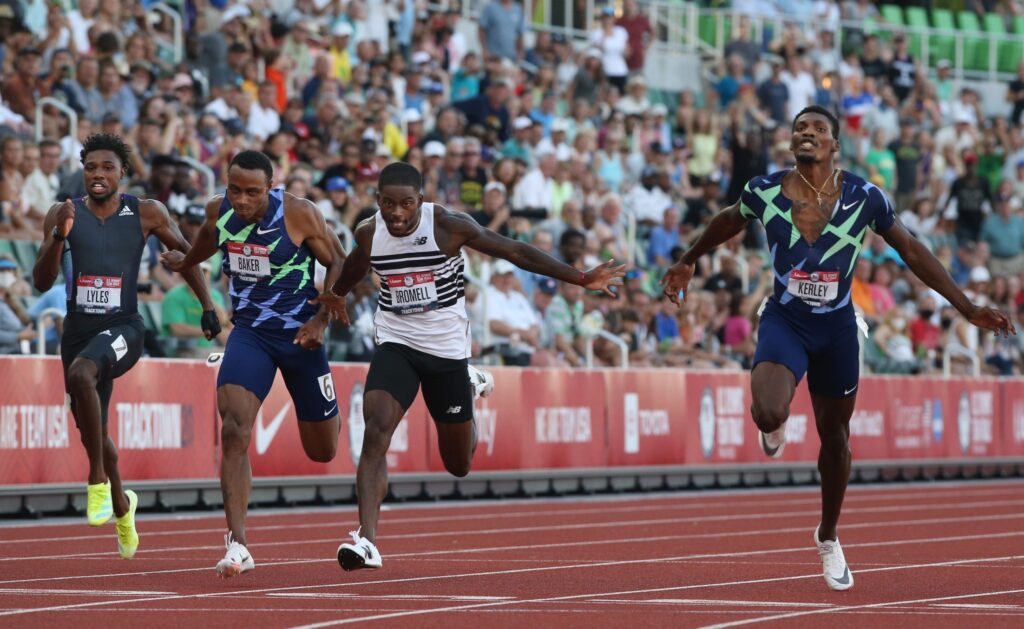 Trayvon Bromell, center, wins the men's 100 meter dash flanked by Ronnie Baker in second, left, and Fred Kerley, right, placing third during the U.S. Olympic Track & Field Trials at Hayward Field in Eugene.  Eug 062021 Trials 05