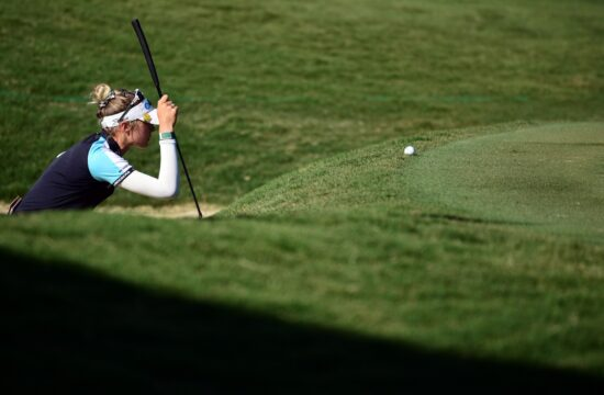 Jun 27, 2021; John's Creek, Georgia, USA; Nelly Korda looks over her putt on the 18th green during the final round of the KPMG Women's PGA Championship golf tournament at the Atlanta Athletic Club. Mandatory Credit: Adam Hagy-USA TODAY Sports