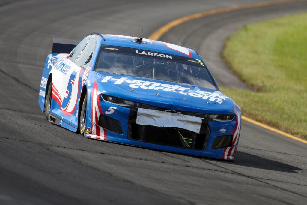 Jun 27, 2021; Long Pond, Pennsylvania, USA; NASCAR Cup Series driver Kyle Larson (5) races during the Explore the Pocono Mountains 350 at Pocono Raceway. Mandatory Credit: Matthew OHaren-USA TODAY Sports