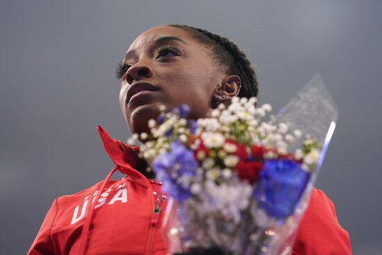 Jun 27, 2021; St. Louis, Missouri, USA; Simone Biles (114) looks on after being announced to the Olympic team during the U.S. Olympic Team Trials - Gymnastics competition at The Dome at America's Center. Mandatory Credit: Grace Hollars-USA TODAY Sports