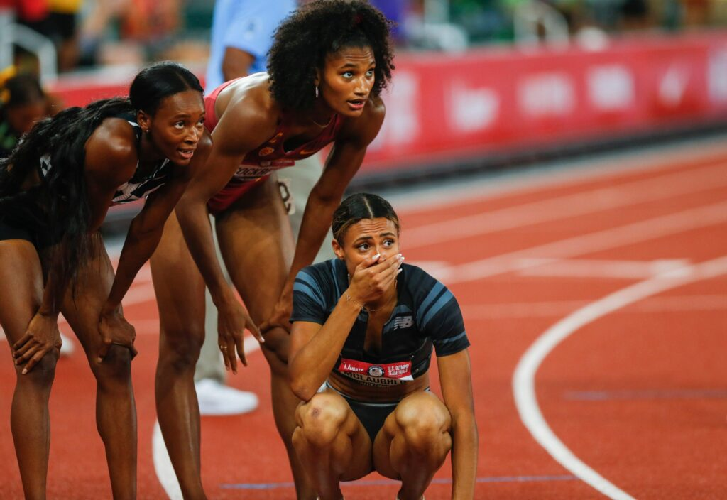 Delilah Muhammad, left, Anna Cockrell, middle and Sydney McLaughlin watch the score board after McLaughlin sets a new world record for the 400 meter hurdle. Muhammad previously set the world record and came in second. Cockrell followed up in third during the final night of the U.S. Olympic Track & Field Trials at Hayward Field.  Eug Sydney Mclaughlin