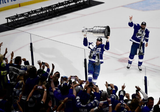 Jul 7, 2021; Tampa, Florida, USA; Tampa Bay Lightning center Brayden Point (21) hoists the Stanley Cup after the Lightning defeated the Montreal Canadiens 1-0 in game five to win the 2021 Stanley Cup Final at Amalie Arena. Mandatory Credit: Douglas DeFelice-USA TODAY Sports