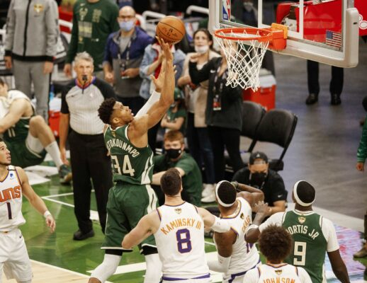 Jul 11, 2021; Milwaukee, Wisconsin, USA; Milwaukee Bucks forward Giannis Antetokounmpo (34) shoots during the fourth quarter against the Phoenix Suns during game three of the 2021 NBA Finals at Fiserv Forum. Mandatory Credit: Jeff Hanisch-USA TODAY Sports