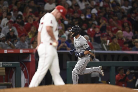 Jul 16, 2021; Anaheim, California, USA; Seattle Mariners right fielder Mitch Haniger (17) rounds the bases after hitting a two-run home run off Los Angeles Angels starting pitcher Dylan Bundy (37) during the seventh inning at Angel Stadium. Mandatory Credit: Kelvin Kuo-USA TODAY Sports