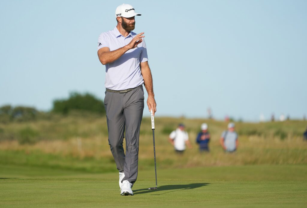 Jul 17, 2021; Sandwich, England, GBR; Dustin Johnson waves to the gallery on the 14th green during the third round of the Open Championship golf tournament. Mandatory Credit: Peter van den Berg-USA TODAY Sports