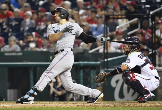 Jul 20, 2021; Washington, District of Columbia, USA; Miami Marlins left fielder Adam Duvall (14) hits a three run home run against the Washington Nationals during the sixth inning at Nationals Park. Mandatory Credit: Brad Mills-USA TODAY Sports