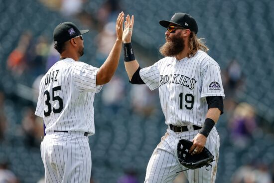Jul 21, 2021; Denver, Colorado, USA; Colorado Rockies right fielder Charlie Blackmon (19) celebrates with catcher Elias Diaz (35) after the game against the Seattle Mariners at Coors Field. Mandatory Credit: Isaiah J. Downing-USA TODAY Sports
