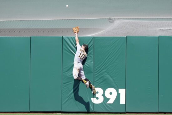 Jul 25, 2021; San Francisco, California, USA; Pittsburgh Pirates center fielder Bryan Reynolds (10) attempts to catch a home run hit by San Francisco Giants shortstop Thairo Estrada (39, not shown) during the eighth inning at Oracle Park. Mandatory Credit: Darren Yamashita-USA TODAY Sports