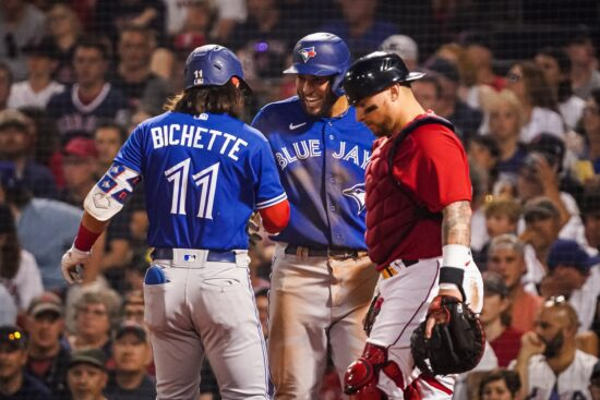 Jul 26, 2021; Boston, Massachusetts, USA; Toronto Blue Jays shortstop Bo Bichette (11) is congratulated after hitting a two run home run against the Boston Red Sox in the fifth inning at Fenway Park. Mandatory Credit: David Butler II-USA TODAY Sports