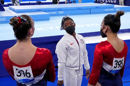 Jul 27, 2021; Tokyo, Japan; Simone Biles (USA) talks with Grace McCallum (USA) and Sunisa Lee (USA) after pulling out of the women's team final during the Tokyo 2020 Olympic Summer Games at Ariake Gymnastics Centre. Mandatory Credit: Robert Deutsch-USA TODAY Sports
