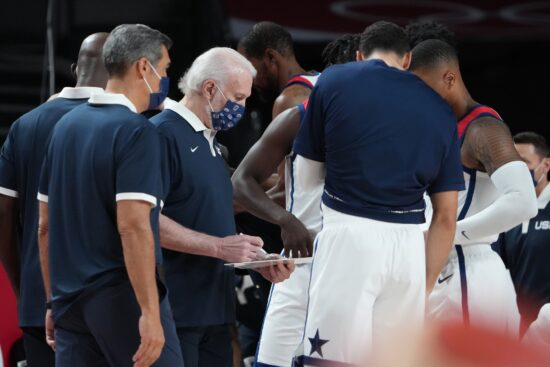 Jul 28, 2021; Saitama, Japan; USA head coach Gregg Popovich, center, works with the team before the start the game against Iran during the Tokyo 2020 Olympic Summer Games at Saitama Super Arena. Mandatory Credit: Kyle Terada-USA TODAY Sports