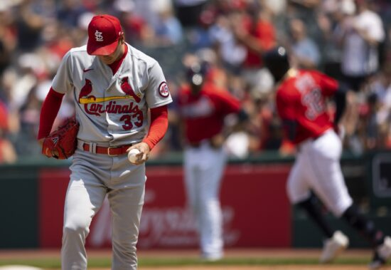 Jul 28, 2021; Cleveland, Ohio, USA; St. Louis Cardinals starting pitcher Kwang Hyun Kim (33) walks back to the pitcherÕs mound following a home run by Cleveland Indians right fielder Franmil Reyes (32) during the first inning at Progressive Field. Mandatory Credit: Scott Galvin-USA TODAY Sports