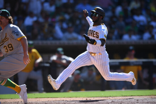 Jul 28, 2021; San Diego, California, USA; San Diego Padres center fielder Jurickson Profar (right) scores a run on a wild pitch by Oakland Athletics relief pitcher Andrew Chafin (39) during the ninth inning at Petco Park. Mandatory Credit: Orlando Ramirez-USA TODAY Sports
