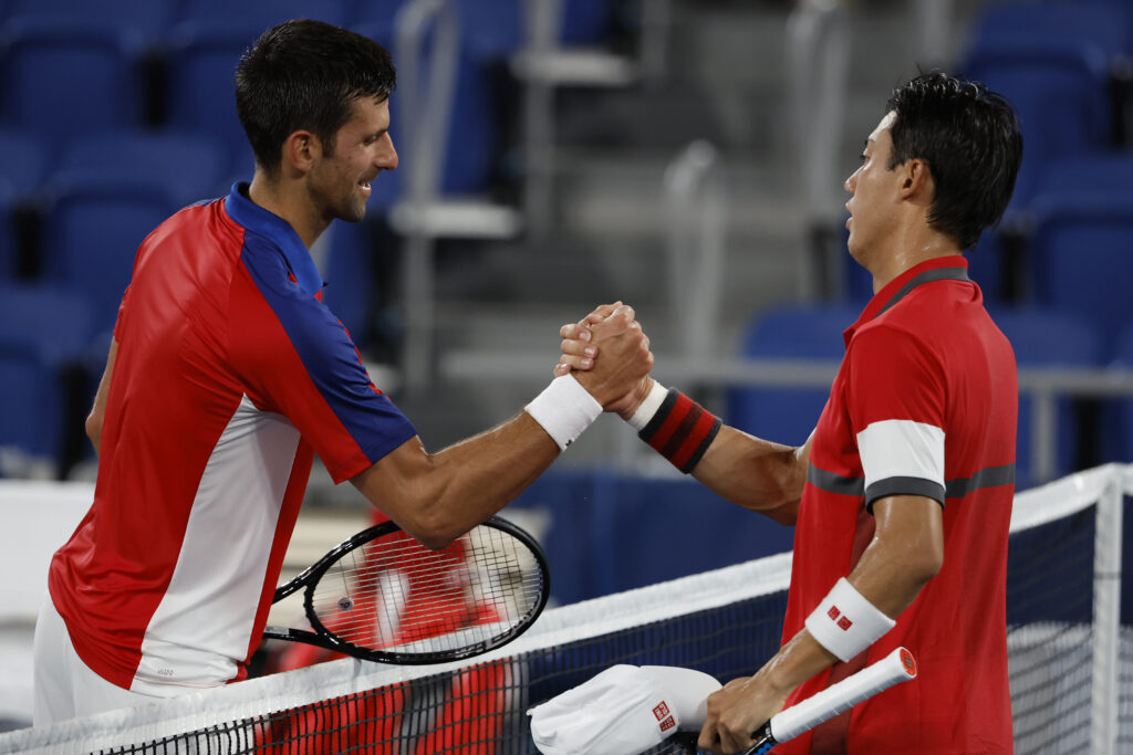 Jul 29, 2021; Tokyo, Japan; Novak Djokovic of Serbia (L) shakes hands with Kei Nishikori of Japan (R) after their match in a men's singles quarterfinal during the Tokyo 2020 Olympic Summer Games at Ariake Tennis Park. Mandatory Credit: Geoff Burke-USA TODAY Sports