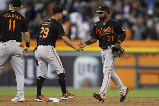 Jul 30, 2021; Detroit, Michigan, USA; Baltimore Orioles center fielder Cedric Mullins (31) celebrates with shortstop Ramon Urias (29) after the game against the Detroit Tigers at Comerica Park. Mandatory Credit: Raj Mehta-USA TODAY Sports