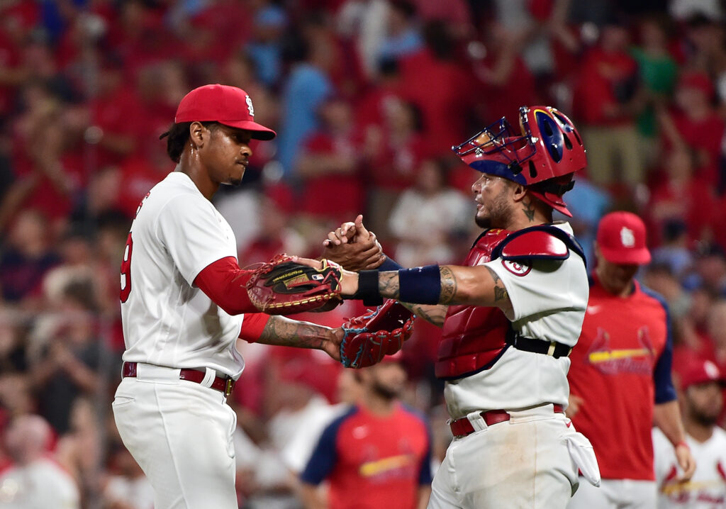 Jul 30, 2021; St. Louis, Missouri, USA;  St. Louis Cardinals relief pitcher Alex Reyes (29) celebrates with catcher Yadier Molina (4) after closing out the ninth inning against the Minnesota Twins at Busch Stadium. Mandatory Credit: Jeff Curry-USA TODAY Sports
