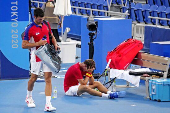 Jul 31, 2021; Tokyo, Japan; Pablo Carreno Busta (ESP) celebrates beating Novak Djokovic (SRB) in the men's tennis bronze medal match during the Tokyo 2020 Olympic Summer Games at Ariake Tennis Park. Mandatory Credit: Robert Deutsch-USA TODAY Sports