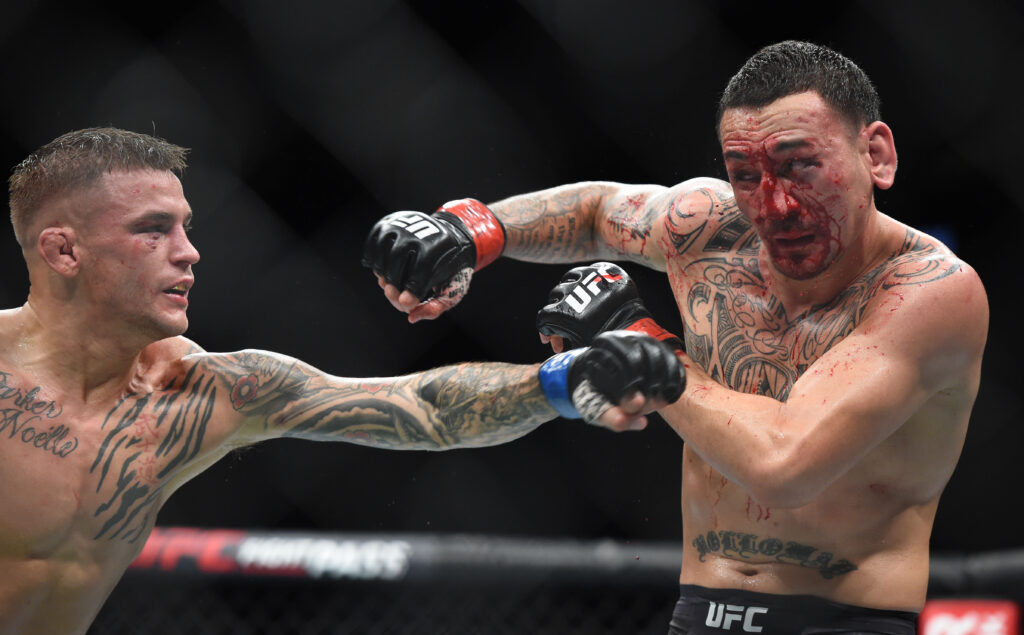 Apr 13, 2019; Atlanta, GA, USA; (EDITORS NOTE: GRAPHIC CONTENT) Max Holloway (red gloves) fights Dustin Poirier (blue gloves) during UFC 236 at State Farm Arena. Poirier won by unanimous decision. Mandatory Credit: John David Mercer-USA TODAY Sports