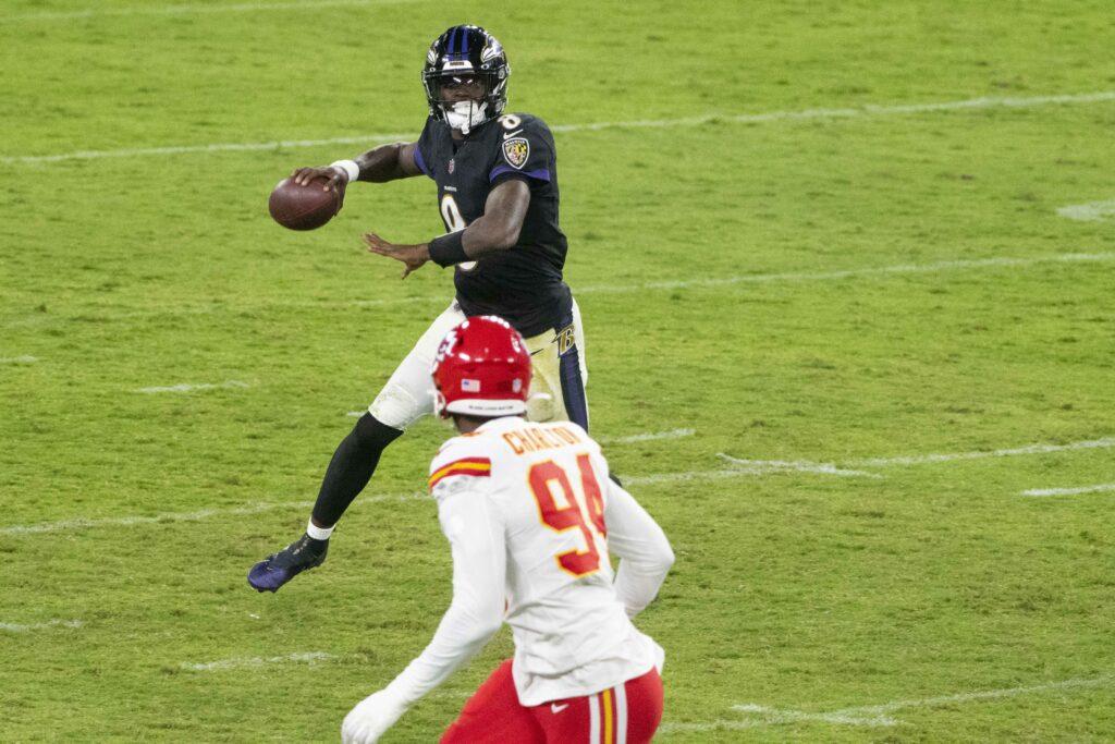 Sep 28, 2020; Baltimore, Maryland, USA;  Baltimore Ravens quarterback Lamar Jackson (8) throws as Kansas City Chiefs defensive end Taco Charlton (94) defends during the second half at M&T Bank Stadium. Mandatory Credit: Tommy Gilligan-USA TODAY Sports