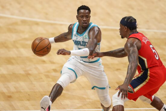 May 9, 2021; Charlotte, North Carolina, USA; Charlotte Hornets guard Terry Rozier (3) brings the ball upcourt against New Orleans Pelicans guard Eric Bledsoe (5) in the second half at Spectrum Center. The New Orleans Pelicans won 112-110. Mandatory Credit: Nell Redmond-USA TODAY Sports