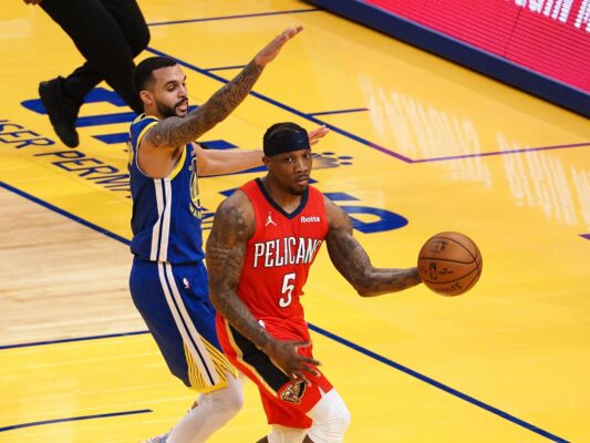 May 14, 2021; San Francisco, California, USA; New Orleans Pelicans guard Eric Bledsoe (5) looks to pass the ball against Golden State Warriors guard Mychal Mulder (15) during the second quarter at Chase Center. Mandatory Credit: Kelley L Cox-USA TODAY Sports