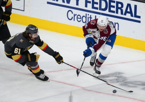 Jun 10, 2021; Las Vegas, Nevada, USA; Colorado Avalanche right wing Mikko Rantanen (96) plays for the puck against Vegas Golden Knights right wing Mark Stone (61) during the third period in game six of the second round of the 2021 Stanley Cup Playoffs at T-Mobile Arena. Mandatory Credit: Gary A. Vasquez-USA TODAY Sports
