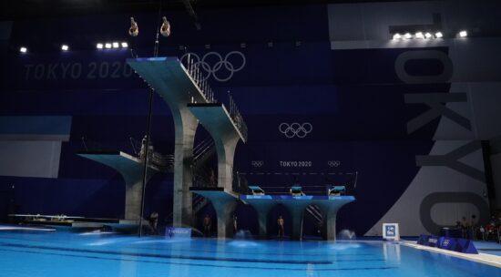 Jul 26, 2021; Tokyo, Japan; Hiroki Ito and Kazuki Murakami (JPN) in the men's 10m platform synchronized diving competition during the Tokyo 2020 Olympic Summer Games at Tokyo Aquatics Centre. Mandatory Credit: Rob Schumacher-USA TODAY Sports