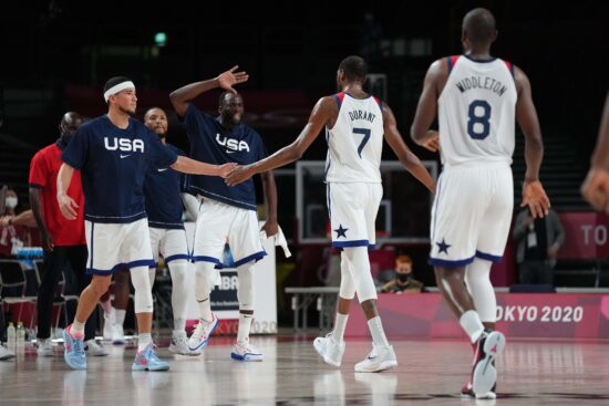 Jul 31, 2021; Saitama, Japan; Team United States guard Devin Booker (15) and Team United States centre Draymond Green (14) celebrate with Team United States forward Kevin Durant (7) at the end of the third quarter against Czech Republic during the Tokyo 2020 Olympic Summer Games at Saitama Super Arena. Mandatory Credit: Kareem Elgazzar-USA TODAY Sports