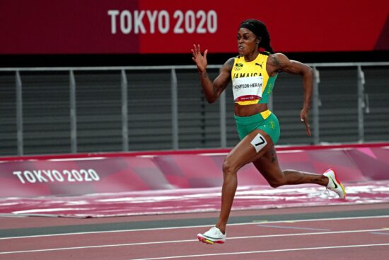 Aug 3, 2021; Tokyo, Japan; Elaine Thompson-Herah (JAM) celebrates winning the gold medal in the women's 800m final during the Tokyo 2020 Olympic Summer Games at Olympic Stadium. Mandatory Credit: Kirby Lee-USA TODAY Sports